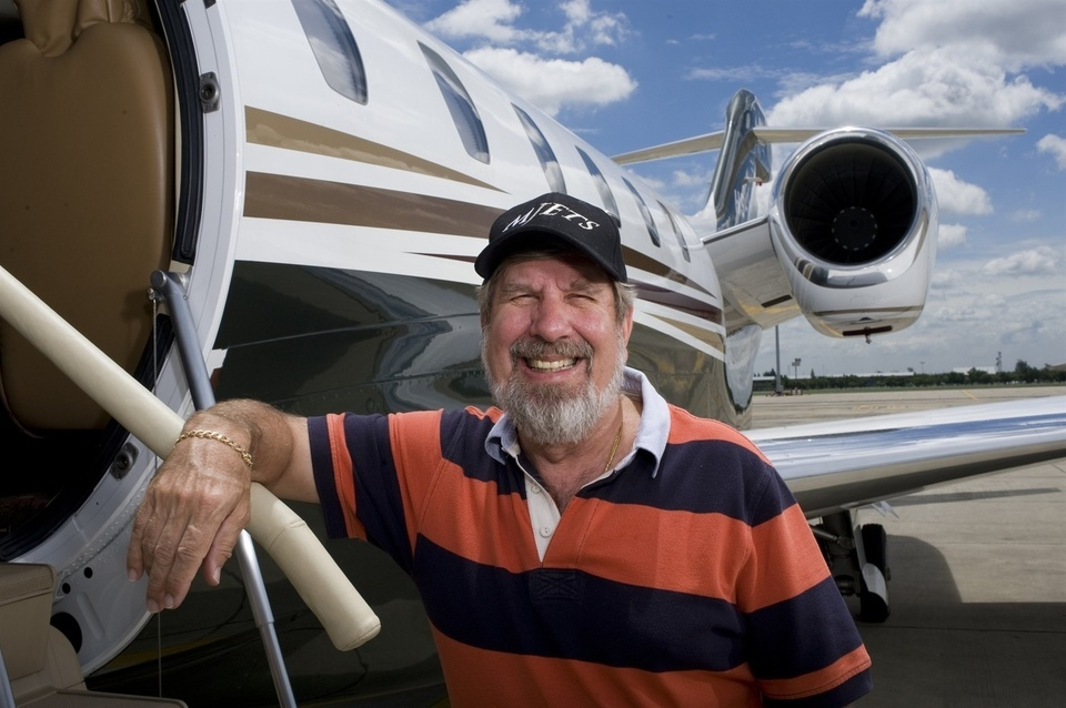 Bill Heinecke, an American who has lived in Asia for most of his life and has taken Thai citizenship poses for a portrait in front of his company jet at Bangkok's second International Airport, Don Muang. He's a self-made multi-millionaire who has built a huge chain of retail and food businesses. His company also owns a growing hotel business with all the Four Seasons hotels in Thailand, several Marriotts, and his own Anantara brand.